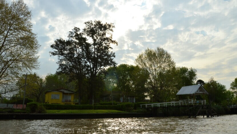Sunset and houses by the river